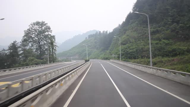 highway driving: short tunnel, descending left turn and bridge