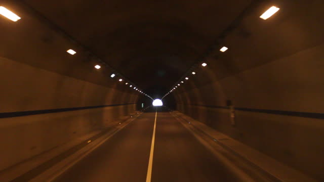 highway driving through a tunnel.