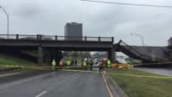 A highway overpass bridge collapsed in OKC at NW Expressway and May Avenue A green truck carrying a forklift hit the bridge and collapsed it
