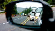 Highway Traffic looking through the mirror