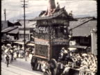 WS MS TD High-wheeled floats, medieval traditional Japanese dress and decorations at Gion festival / Kyoto, Japan / AUDIO