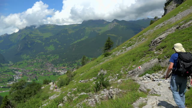Hiker on the way to Baregg, Grindelwald, Bernese Alps, Switzerland, Europe