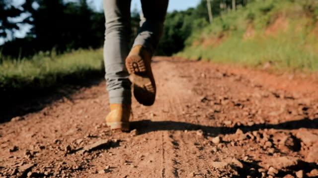 Hiker running on Mountain Trail