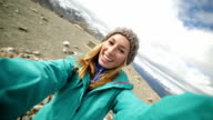 hiker takes 360 degree selfie from mountain top