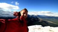 Hiker takes 360 degree view selfie on mountain top