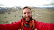 hiker takes 360 degree view selfie portrait