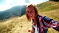 Hiker taking selfie on mountain top