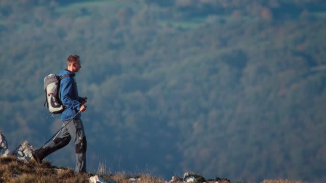 Hiker walking down the mountain
