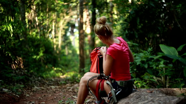 Hiker woman having a rest-Forest
