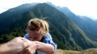 Hiker woman reaching mountain top