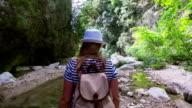 Hiker woman walking trough a forest