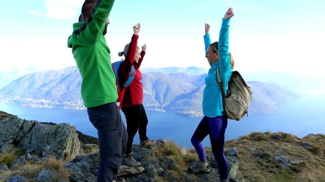 Hikers celebrating success at mountain top
