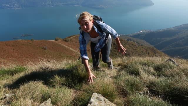 Hikers clibing mountain range