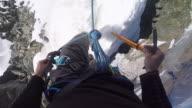 POV hiking icy mountain ridge