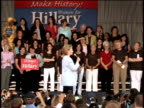 Hillary Clinton making a presidential campaign stop and hugging organizers including comedian Caroline Rhea at kickoff of Club 44 an organization...