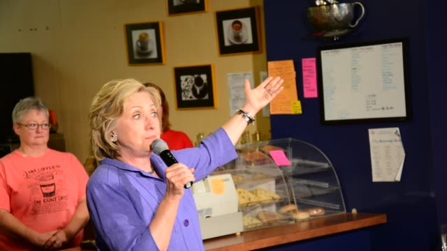 Hillary Clinton speaking to a cafe full of Iowa voters