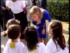 Hillary Clinton talks to children about why she is campaigning on behalf of her husband Texas USA 1992