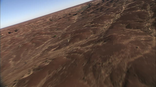 Hills and valleys cover the Kalahari Desert in Botswana. Available in HD.