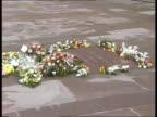 Hillsborough Memorial service ITN TS Flowers round memorial stone ZOOM IN wording