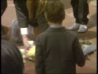 Hillsborough Memorial service ITN EXT MS People on Cathedral steps as children lay flowers TCMS Children laying flowers round memorial stone CMS Man...