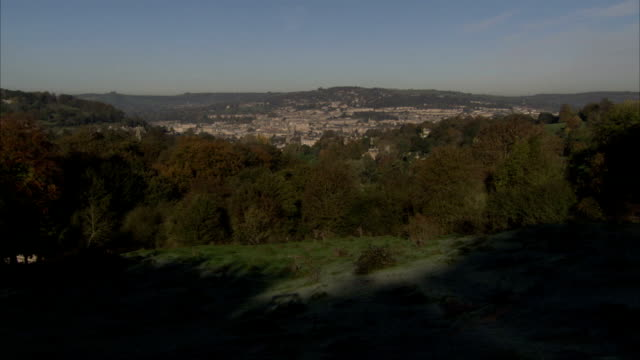 A hilltop overlooks the Bath cityscape. Available in HD.