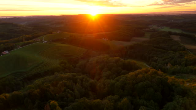 AERIAL Hilly Countryside In The Sunset