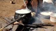 CU Himba Woman Cooking On Log Fire
