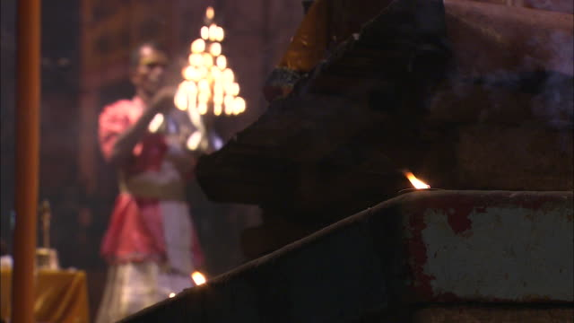Hindu monks use burning torches for puja during India's Diwali festival.