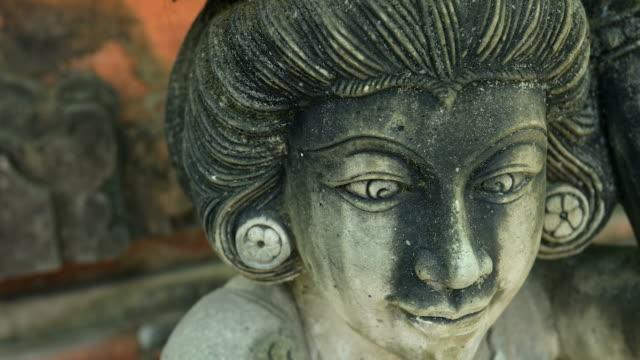Hindu statue in a Bali temple in macro motion video