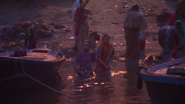 Hindu women perform ablutions in the waters of the Ganges in the city of Varanasi.