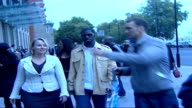 Hiphop artist Rhymefest arriving for meeting with David Cameron / interview Rhymefest along down street with McAndrew / Various of Rhymefest walking...