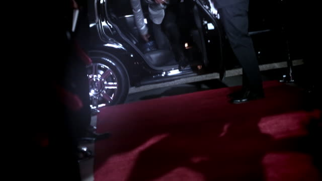 Hip-hop star jumps out of limousine, signs autographs, and dances across red carpet at awards show