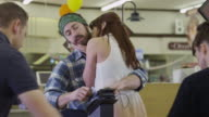 Hippie couple making out in diary section of grocery store / Highland, Utah, United States,