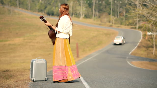 Hippie woman playing music and dancing