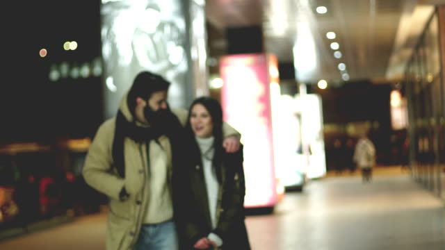 Hipster couple walking on street
