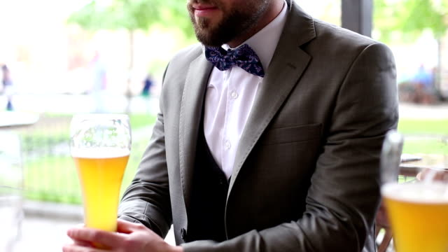 Hipster elegant Business man drinking beer in pub