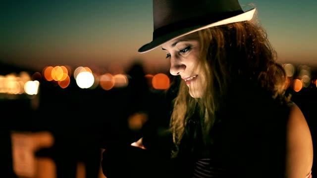 hipster girl using smart phone at night