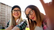 Hipster  girls making selfie
