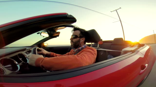 WS POV Hipster Listening To The Music While Driving Convertible