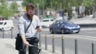 LS Hipster using a smartphone on his bike in the city