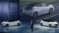 Hiroto Saikawa president and chief executive officer of Nissan Motor Co speaks in front of the company's new Leaf electric vehicle at the unveiling...