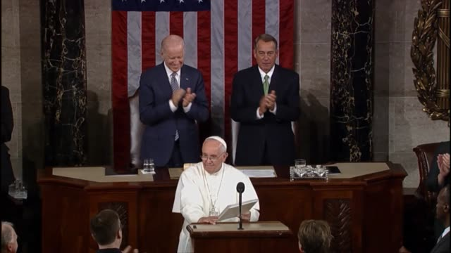 His Holiness Pope Francis slowly exits the hall of the House to warm applause following a historic address to Congress and the nation