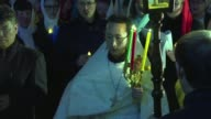 His red and gold vestments bathed in candlelight the first mainland Chinese Orthodox priest ordained for six decades leads an Easter service on...