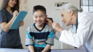 Hispanic Boy's Pediatrician Visit, Ears