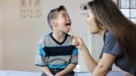 Hispanic Boy's Pediatrician Visit, Throat