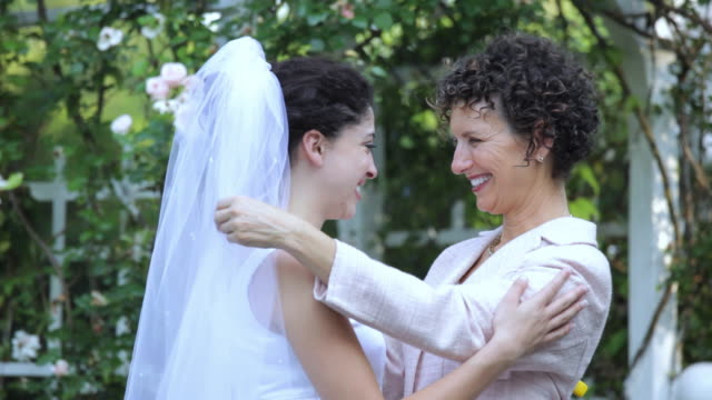 TD hispanic bride hugging mother, Richmond, Virginia, United States