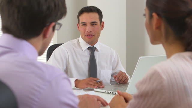 Hispanic businessman advising couple