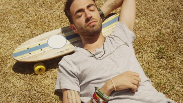 hispanic sleeping napping outdoors
