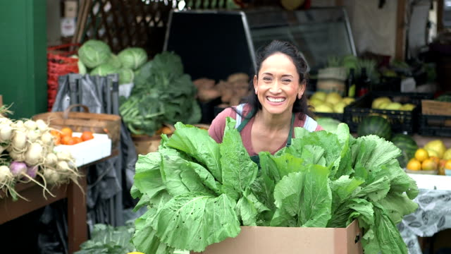 Hispanic woman working at produce stand