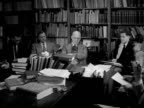 Historian Yale University History professor Samuel Flagg Bemis sitting in library w/ Yale students talking about American foreign policies Lecture